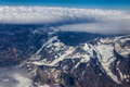 Cordillera de los andes the top of the ever snowy high mountains of in chile in the middle of the clouds Royalty Free Stock Photos