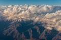 Cordillera de los andes the top of the ever snowy high mountains of in chile in the middle of the clouds litten by the orange Stock Photography