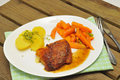 Cordon bleu schnitzel with carrots and potatoes Stock Photos