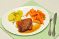 Cordon bleu schnitzel with carrots and potatoes Stock Photo