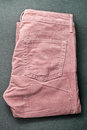 Corduroy trousers folded pair of pink Stock Image