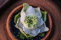 Core of pureness royal white lotus blooming in traditional thai style pottery Royalty Free Stock Image
