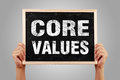 Core values hands are holding the blackboard of with gray background Stock Photo