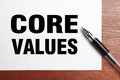 Core values text is on white paper with black pen aside Stock Images