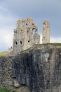 Corfe castle from beyond the moat against a stormy sky Royalty Free Stock Photography