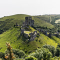 Corfe castle is a fortification standing above the village of the same name on the isle of purbeck in the english county of dorset Stock Photos