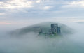 Corfe castle on a misty morning. Royalty Free Stock Photo