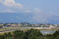 Corfu international airport wide shot of ioannis kapodistrias with runway platform and departing aircraft in the distance highest Royalty Free Stock Photo