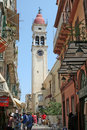 Corfu street a in the city of kerkyra island greece with the tower of st spyridon church in the background Stock Images