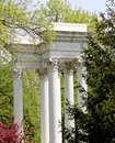 Corinthian column monument an aged and weathered stone featuring columns surrounded by trees at graceland cemetery chicago Stock Photos
