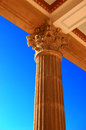 Corinthian column ornate supports a beamed roof against a brilliant cerulean sky Royalty Free Stock Photos