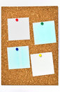 Cork board and blank notes. Royalty Free Stock Image