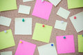 Cork board with many sticky notes pinned Royalty Free Stock Photo