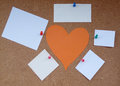 Cork board papers heart of the paper around the paper notes Stock Photos