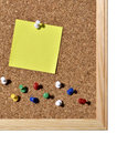 Corkboard cork board with blank pins and post it Royalty Free Stock Images