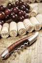 Corks of different wine years in a row corkscrew in front selective focus Royalty Free Stock Photography