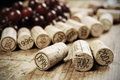 Corks of different wine years in a row red grapes in the background selective focus shallow dof Royalty Free Stock Image