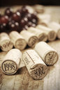 Corks of different wine years in a row red grapes in the background selective focus very shallow dof Royalty Free Stock Photography