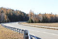 Corkscrew road the twisting through the dense autumn wood Stock Photography