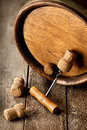 Corkscrew and wooden cask with corks on a table Stock Image