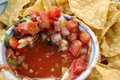 Corn chips around a bowl of red chunky salsa Royalty Free Stock Image
