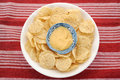 Corn chips and dip on red background Stock Image