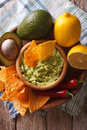 Corn chips, sauce guacamole and ingredients closeup. vertical Royalty Free Stock Photo