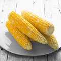 Corn on the cob wooden background Royalty Free Stock Photography
