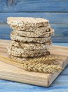 Corn crackers on a blue wooden table. Royalty Free Stock Photo