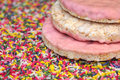 Corn crackers with strawberry covering over sprinkles for cake decoration Stock Photos