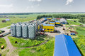 stock image of  Corn dryer silos standing in a field of corn