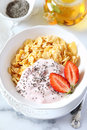 Corn flakes in bowl yogurt strawberries and chia seeds healthy breakfast Royalty Free Stock Image