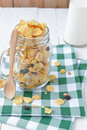 Corn flakes bran and raisin cereal with nut and grain in mason j Royalty Free Stock Photo
