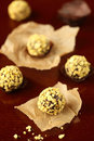 Corn flakes chocolate truffles on a baking paper on a dark background Royalty Free Stock Image