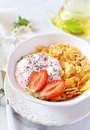 Corn flakesl yogurt strawberries and chia seeds healthy breakfast flakes in bowl Royalty Free Stock Image