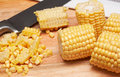 Corn kernels on the wooden board Stock Photo