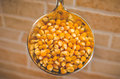 Corn in a laddle some unpopped con on Royalty Free Stock Photography