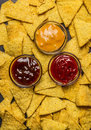 Corn tortilla chips background with dips various top view close up a Royalty Free Stock Images