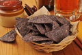 Corn tortilla chips and beer a basket of blue a mug of Royalty Free Stock Photography