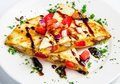 Corn tortilla stuffed with chicken cheese and vegetables on white plate Royalty Free Stock Photos