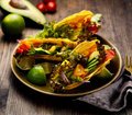 Corn tortilla tacos with avocado, tomatoes, onion and lettuce Royalty Free Stock Photo