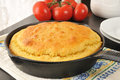 Cornbread in a cast iron skillet fresh baked cooling near the window Stock Photography