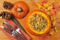 Cornbread stuffing or herbal in a pumpkin from above Stock Photos