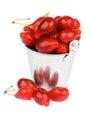 Cornel heap of raw ripe cornelian in tin bucket isolated on white background Royalty Free Stock Photography
