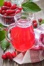 Cornel juice from fresh berries cornelian cherry Stock Images