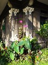 Corner of balinese garden a photograph showing a quiet sunny in a bali next to an old stone house with ornamental architectural Stock Image