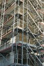 A corner of a construction site of a large residential building covered with scaffolding possibly as matching as a background Royalty Free Stock Photo