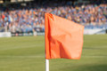 Corner flag on soccer field during a football mach an Stock Photo