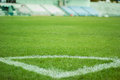 Corner on the green grass in stadium Royalty Free Stock Photography