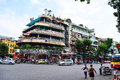 A Corner of Hanoi, near Hoan Kiem Lake, Center of Hanoi. Vehicles running on a busy street.